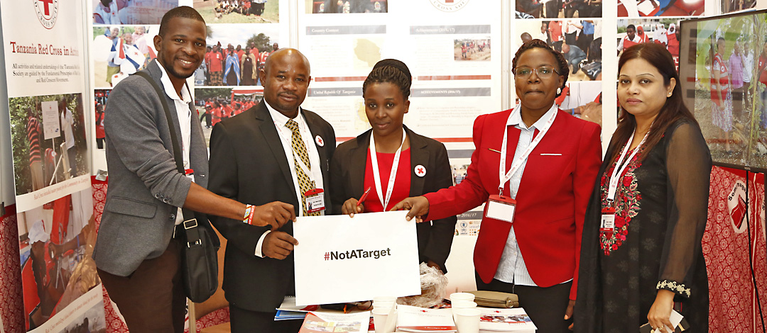 "Antalya Turkey,November 10,2017 Red Cross Red Crescent Statutory Meetings,The Members of  Tanzania Red Cross Society with""notararget"" signboard are in exhibition area."